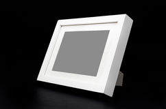 White picture frame on black Royalty Free Stock Images