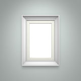 White picture frame on gray wall Royalty Free Stock Photography