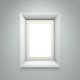 White picture frame on gray wall. Background. 3d rendering Royalty Free Stock Photo