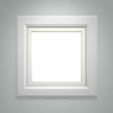 White picture frame on gray wall Royalty Free Stock Image