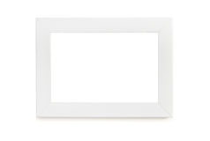 White picture frame over white background. Plain picture frame over white Royalty Free Stock Images