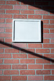 White Picture Frame on Red Brick Wall Landscape. Add your own text to this image or download the PNG with transparent frame area to insert your own picture with stock photography