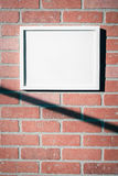 White Picture Frame on Red Brick Wall Landscape Vertical. Add your own text to this image or download the PNG with transparent frame area to insert your own royalty free stock photos