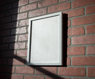 White Picture Frame on Red Brick Wall Portrait Angled Stock Image