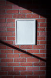 White Picture Frame on Red Brick Wall Portrait Vertical. Add your own text to this image or download the PNG with transparent frame area to insert your own royalty free stock photo