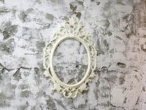 White picture frame on wall. A white picture frame on wall Stock Photos