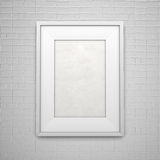White picture frame on wall. White empty picture frame on brick wall Royalty Free Stock Photos