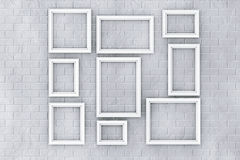 White Picture Frames on a Brick Wall Royalty Free Stock Photo