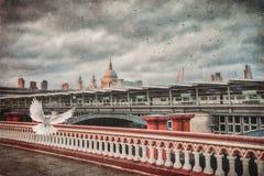 White pidgeon flying over Blackfriars Bridge. London Royalty Free Stock Image
