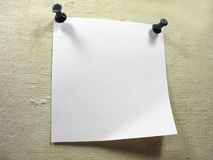 White piece of notice paper over a old canvas Royalty Free Stock Photography