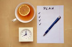A white piece of paper with a plan of the day and tea Stock Photos