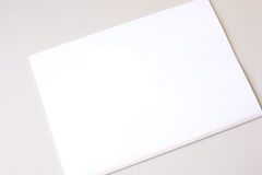 White piece of paper on white background Stock Image