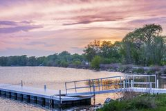 White pier at sunset on Lake in WI. Pier at sunset on Wisconsin lake Stock Images