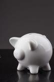 White piggy bank on black background Stock Image