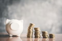 White piggy bank and coin on wood Stock Photography