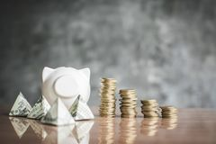 White piggy bank and coin on wood Stock Image