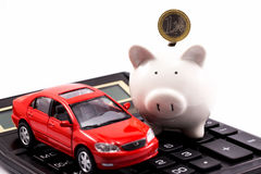 White piggy bank with euro and car Stock Photos