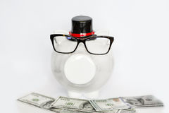 White piggy bank with eyeglasses  with money on a white background Stock Images