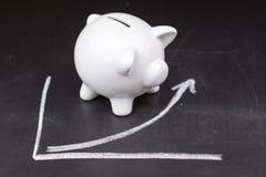 White piggy bank on a graph Stock Image
