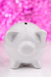 White piggy bank on pink background Stock Photos