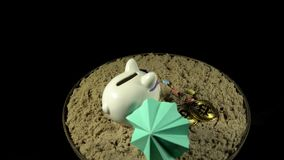 A white piggy bank stands on a sandy beach and revolves on a black background. A white piggy bank in lilac sunglasses stands in the sand next to a green stock footage
