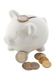 White piggy banks with euro coins, isolated Stock Photo