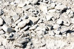 Hardcore Rock Rubble Broken Cement. White piles of hardcore rock rubble from broken cement on the ground Stock Image