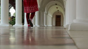 White Piling Corridor. Steps on a hallway with arches along and on sides and and also whitewashed pillars. Floor is paved with marble stock video footage