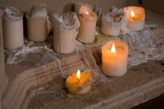 White Pillar Candle burning closeup. Royalty Free Stock Photos