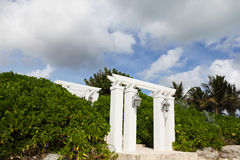 White pillars on the beach. White pillars of gates on the beach, entrance to the mansion Stock Photography