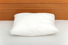 White pillow. Lying on bed Stock Image