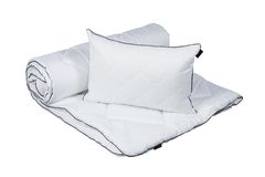 White pillow and blanket isolated Stock Image