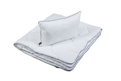 White pillow and blanket isolated Royalty Free Stock Photo