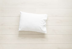 White pillow on the floor stock images
