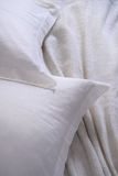 White pillow messy bed. White pillow on a messy bedsheet stock images