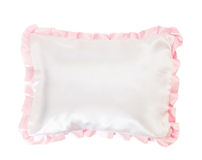 White pillow with a pink frill Royalty Free Stock Photo