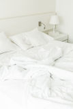 White pillow on rumpled bed Stock Photography