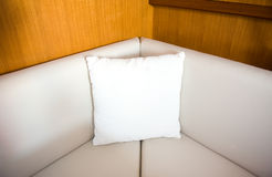 White pillow on sofa Stock Images