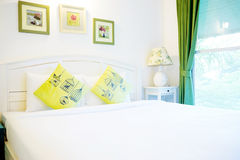 White pillows and bed Stock Images