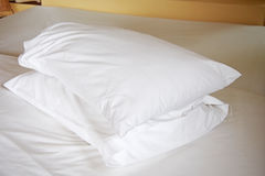 White pillows on bed Royalty Free Stock Image