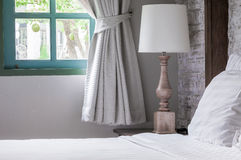 White pillows and blanket on bed in the morning shine. Bedroom Stock Photos