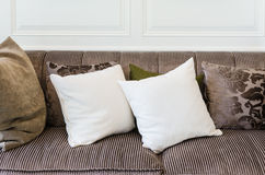 White pillows on  brown sofa Royalty Free Stock Photos