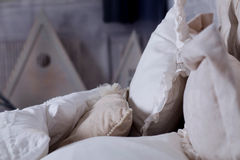 White pillows on classic bed in bedroom. Photo of white pillows on classic bed in bedroom Stock Photography