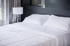 The White pillows on comfortable bed Royalty Free Stock Image