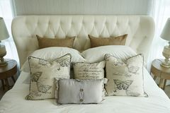 White pillows setting on English country style bedding. Off white pillows setting on English country style bedding in bedroom Stock Photography