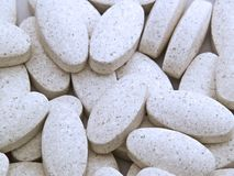 White Pills. Mass of white pills laying on each other Royalty Free Stock Image