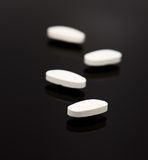 White pills Stock Images