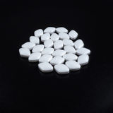 White Pills on black background. White pills on white background Royalty Free Stock Photos