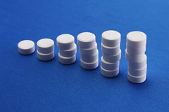 White Pills On Blue Stock Photography