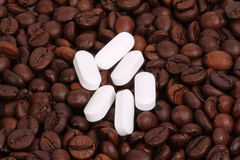 White pills with coffee beans Stock Photos